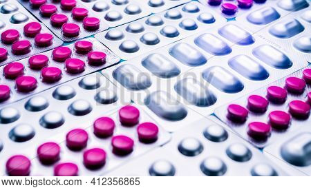 Pink Tablets Piils In Blister Pack And Silver Aluminium Foil Pack Of Pills. Pharmaceutical Industry.