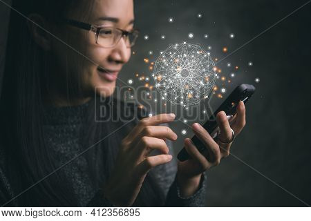 Asian Woman Using A Smartphone With Virtual World And Connection.society Of Connection Concepts.