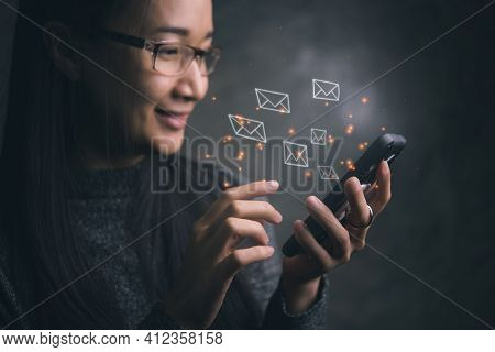 Woman Sending E-mail Message To Mailing List Contacts Using Smartphone,