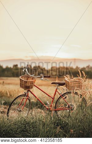Beautiful Landscape Image With Bicycle At Summer Grass Field.classic Bicycle,old Bicycle Style For G