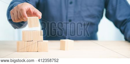 Hand Stack Woods Block Step On Table. Business Development Decide And Choose Concept.copy Space.