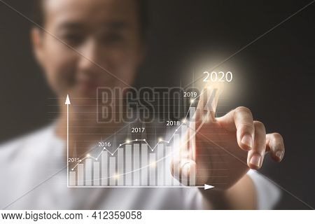 Woman Touching On Screen.plans To Increase Business Growth And An Increase In The Indicators Of Posi