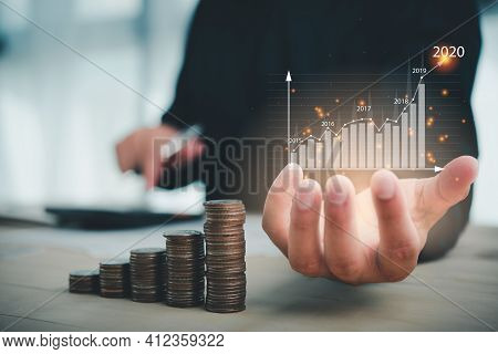 Businessman Use Calculator Plans To Increase Business Growth And An Increase In The Indicators Of Po