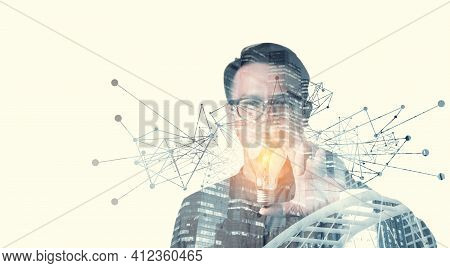 Double Exposure Of Businessman Holding Light Bulb. Idea Concept With Innovation And Inspiration Crea