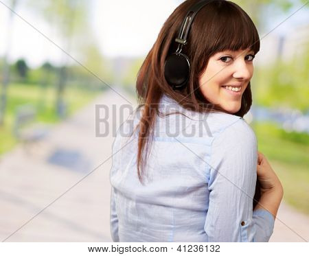 Happy Woman Wearing Headphone, Outdoor
