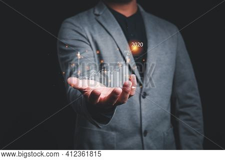Business Man Holding Graph Virtual Screen.plans To Increase Business Growth And An Increase In The I