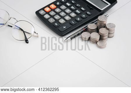 Copy Space , Money Coins And Stationary In White Color Style For Money , Banking , Finance And Busin