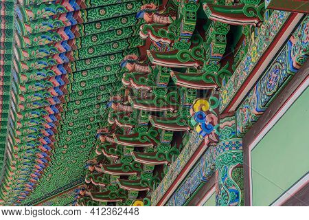 Closeup Of Colorful Eves Of Korean Buddhist Temple Building.