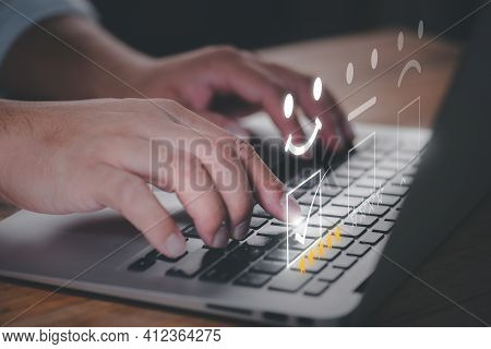 Satisfaction Survey And Customer Service Concept.business Person Using Computer Notebook To Answer Q