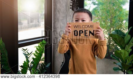 Asian Baby Boys Are Very Cute Handsome And Good Looking, Holding A Sign Showing The Word