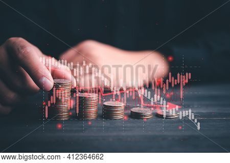 Chart With Red Down Arrow With Businessman Stacking Rows Of Coins. Falling Growth In Business. Graph