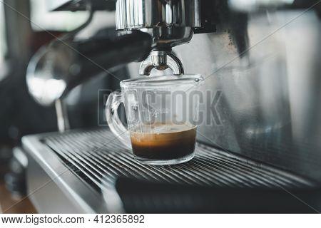 Espresso Coffee Pouring From Espresso Machine. Barista Details In Cafe