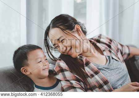 Loving Mother Smiling Cute Funny Kid Boy Having Fun Together, Happy Family Mom With Little Son Playi