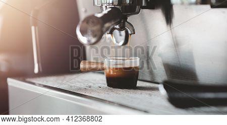 Fresh Morning Espresso Coffee With Beautiful Tiger Crema Pouring Through The Bottomless Portafilter