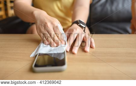 Woman Hands Using Alcohol On Tissue Clean Mobile Phone Before Use It For Protect Coronavirus Or Covi