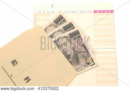 Japanese Money And Passbook With Salary Bag Isolated On White Background. Translation: Salary, Year,
