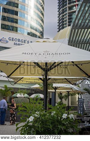 Brisbane, Queensland, Australia - March 2021: Inner City Dining Venue Shaded By Umbrellas Decorated