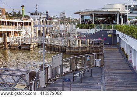 Brisbane, Queensland, Australia - March 2021: Showboat Cruise Docked At River Wharf