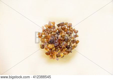 Amber Of A Fine Fraction Of Yellow Brown Color Scattered Isolated On A White Background, Fossilized