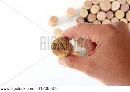 Cork With A Number In Hand. New Year 2020