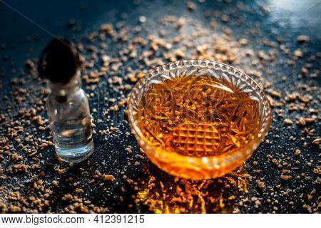 Hand Moisturizer Consisting Of Non-toxic Glycerine Well Mixed With Honey And Oatmeal On A Black Surf