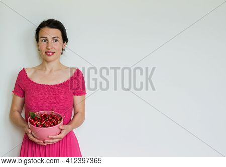Red Ripe Cherries In Bowl In Hands Of Woman. Healthy Eating, Vegetarian Food And Diet People Concept