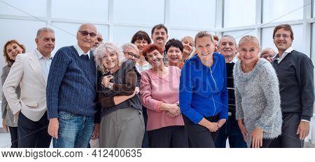 group of happy seniors look at camera