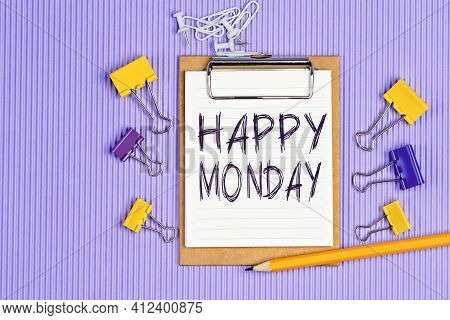 The Words Happy Monday Written On A White Notebook. Closeup Of A Personal Agenda