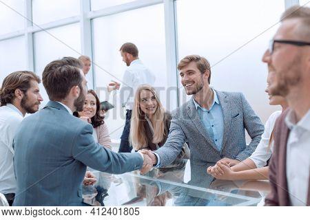handshake business people at an informal meeting
