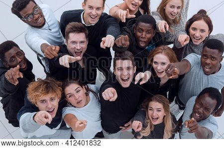 multiethnic group of five male and female friends hugging and lo