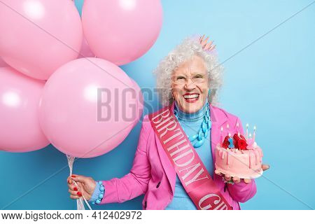 Happy Senior Lady Smiles Broadly Shows White Teeth Going To Celebrate Birthday In Company Of Friends