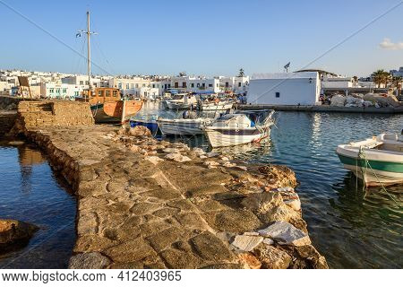 Paros, Greece - September 27, 2020: Naoussa Harbor With Colorful Boats And Houses In The Cycladic St