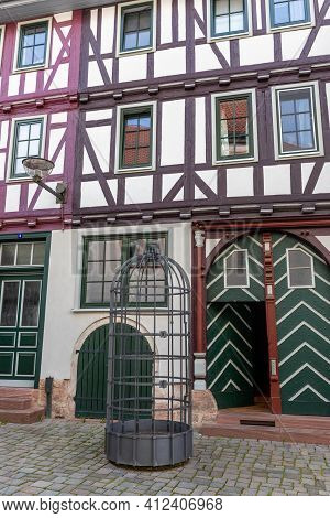 Facades Of Half-timbered Houses In  Schmalkalden, Thuringia And Cage In The Foreground