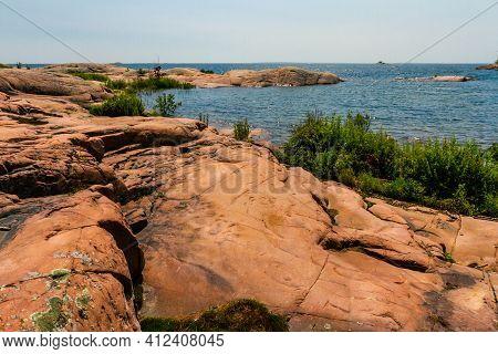 Detail Of Granite Shoreline Along Lake Huron. Granite Rocks At The Mouth Of The Chikanishing Creek A