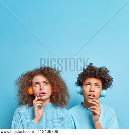 Vertical Shot Of Thoughtful Diverse Women Concentrated Above Hold Chin Daydream About Something List