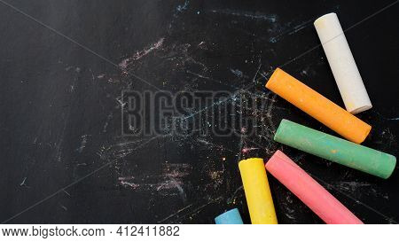Colored Chalk On A Blackboard. Blackboard With Crayons. The Concept Of School