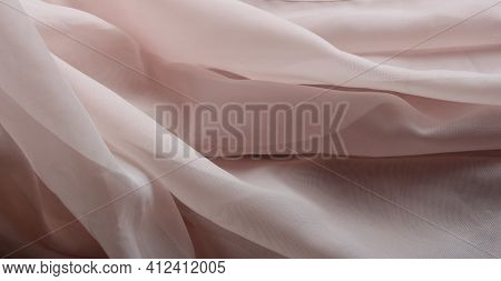 Pink Weightless Fabric With Light Waves Lying On The Surface, A Fragment Of Curtains From Delicate G