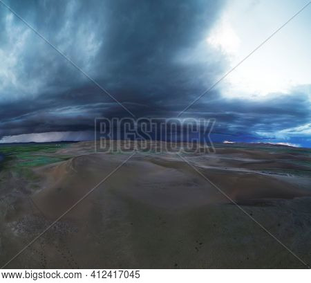 Aerial panorama storm clouds over sand desert Mongol Els
