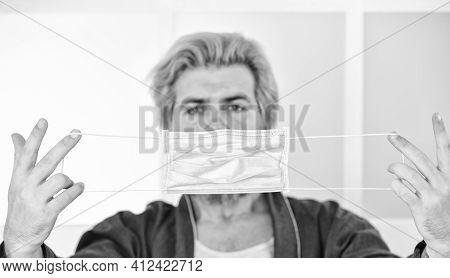 Medical Mask As Corona Protection. Man Hold Respirator Protective Mask, Selective Focus. Coronavirus
