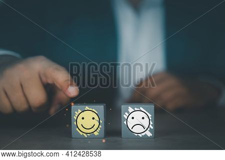 Close Up Customer Hand Choose Smiley Face Icon On Wood Cube. Service Rating, Satisfaction And Custom