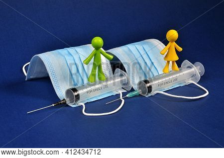 Preventive Vaccination, Disposable Syringes And Antibacterial Protective Masks.