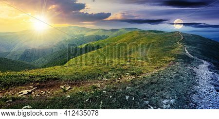 Day And Night Time Change Concept Above The Mountain Landscape In Spring. Path Through Meadow In Gra