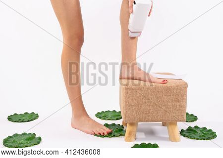 Hair Removal. Fit Young Woman Waxing Her Legs With A Portable Roll-on Depilatory Wax Heater For Pain