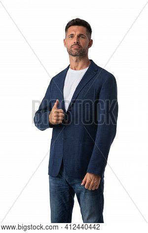 Portrait Of Handsome Mid Adult Serious Business Man Dresses In Jeans And Blue Blazer Posing With Thu