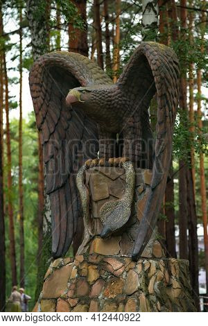 Novokuznetsk. Russia. August 15, 2020. Sculpture Of An Eagle With A Cobra In Its Claws On The Territ