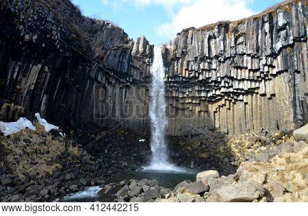 Spring Day At An Icelandic Basalt Column Waterfall.