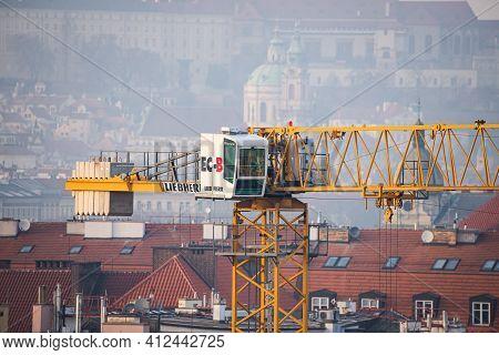 Prague, Czech Republic - February 24, 2021. Yellow Liebherr Crane In Detail Above Prague Center