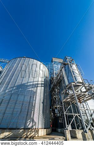 High Metal Frames In The Construction Site. Special Grain Elevators For Crop Storage. Steel Structur