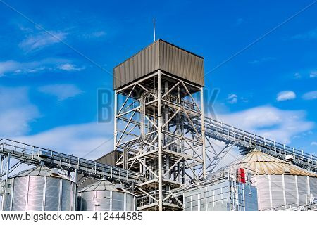 Metal Stairs At Factory. Steel Construction At Plant. Modern Equipment. Blue Sky With Clouds Above.