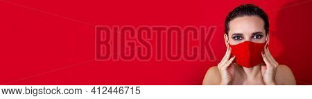 Horizontal Banner. Woman With Bright Makeup Holding Protective Stylish Red Face Mask And Looking For